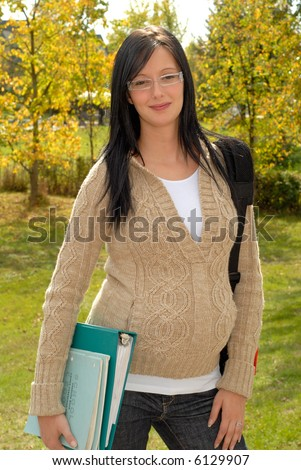 beautiful pregnant teen school girl outdoors stock photo (safe to
