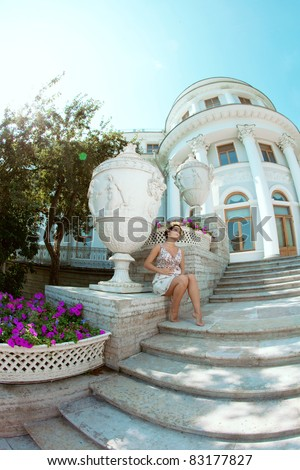 Beautiful pregnant woman against the backdrop of the palace - stock photo