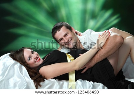 beautiful pregnant woman and man in studio