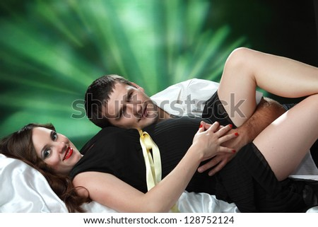 beautiful pregnant woman and man in studio - stock photo