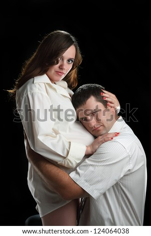 beautiful pregnant woman and man in the studio