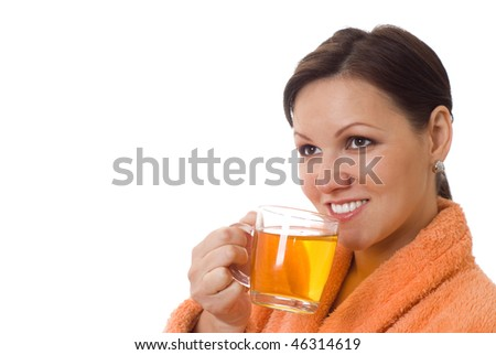 beautiful pregnant woman drinking in an orange smock with a white