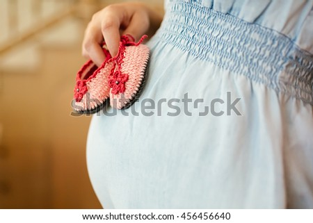 Beautiful pregnant woman expecting a girl - stock photo