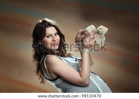 beautiful pregnant woman in an artistic photo shoot - stock photo