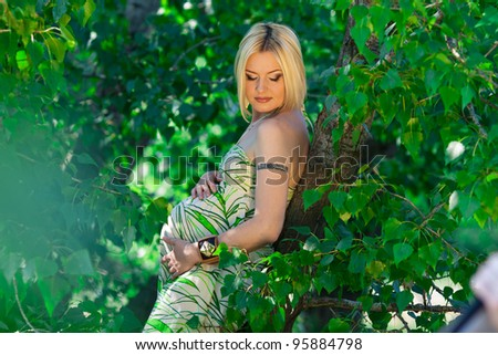 beautiful pregnant woman in sunny day