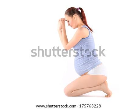 Beautiful pregnant woman making yoga - stock photo