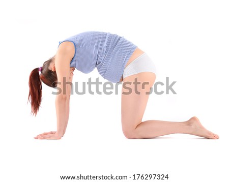 Beautiful pregnant woman making yoga