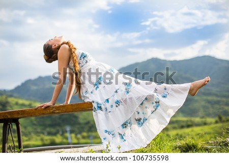 Beautiful pregnant woman meditating on  nature of Almaty.  Young woman doing yoga - stock photo