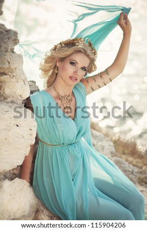 stock photo beautiful pregnant woman outdoor in greek goddess style with her tummy on sunset near sea young 115904206