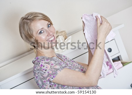 beautiful pregnant woman prepares for the baby