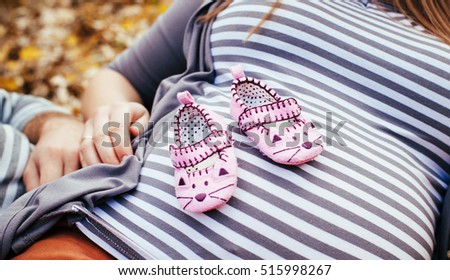 Beautiful pregnant woman with a big belly and shoes