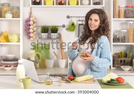 beautiful pregnant woman with    food