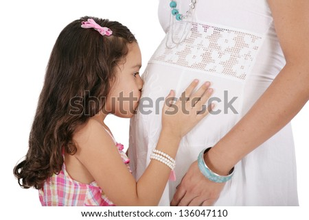 Beautiful pregnant woman with her daughter. Isolated on white background - stock photo