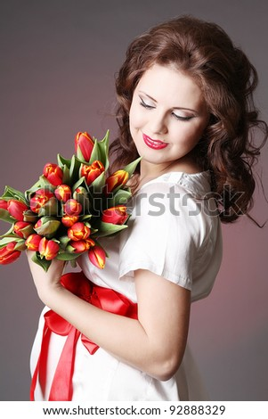 beautiful pregnant woman with red flower