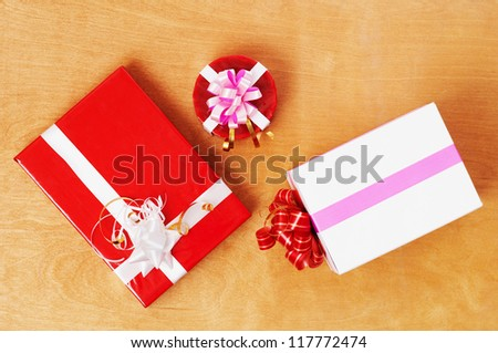 Beautiful presents  in the wood table - stock photo