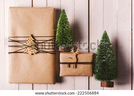 Beautiful presents with Xmas decoration. / Christmas handcraft gift boxes on wood background.