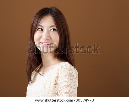 Beautiful pretty young woman on brown background