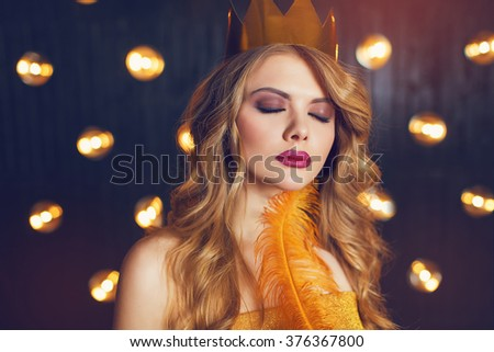 Beautiful princess in a gold crown