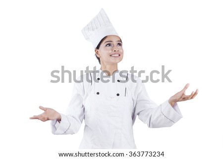 Beautiful professional chef woman showing empty copy space, isolated on white background - stock photo