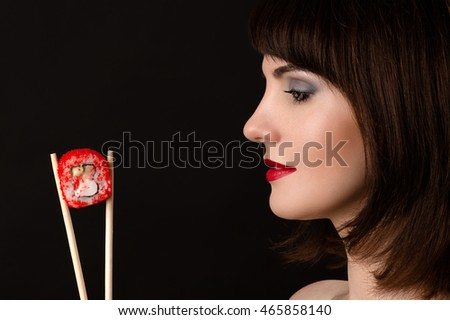beautiful profile face woman with chopsticks and roll
