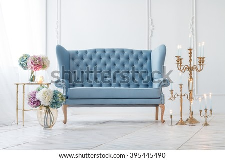 Beautiful Provance Living Room With Blue Sofa Near Table With Flowers And Candles - stock photo