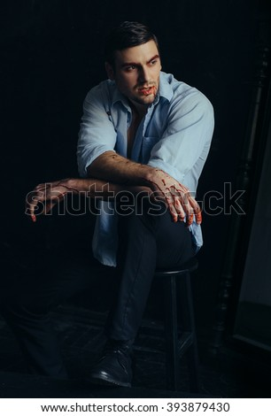 Beautiful pumped man in white   shirt with blood posing over a black background,The Vampire Diaries,, a fashionable toning, creative color