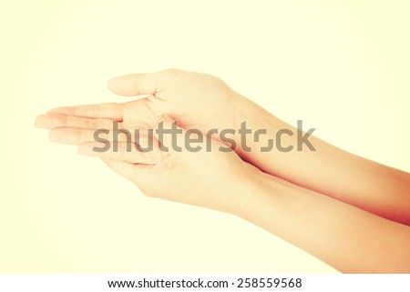 Beautiful pure and smooth female hands. - stock photo