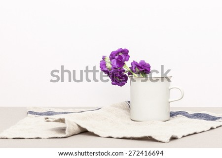 Beautiful purple flowers with cup for wedding event in the ivory background - stock photo
