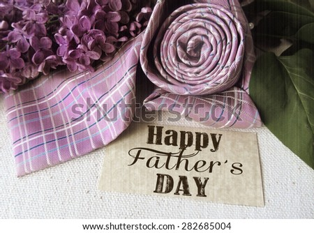 Beautiful purple lilac and tie for father's day. Greeting card. Abstract concept background for father's day celebration. - stock photo