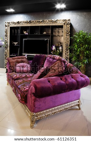 Beautiful purple sofa in a modern apartment