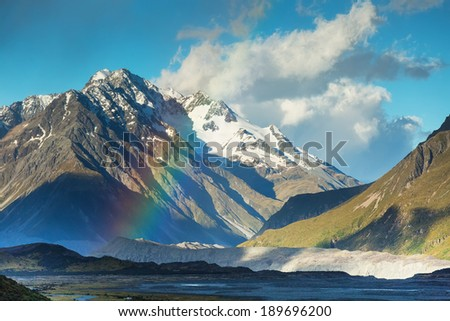 Beautiful rainbow at Mt Cook National park Southern Alps mountain valleys South island New Zealand - stock photo