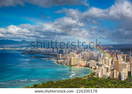 Beautiful rainbow over Hawaii skyline - stock photo