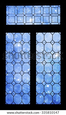Beautiful realistic blue color heavy snowfall with sparkle viewed through closed framed window.