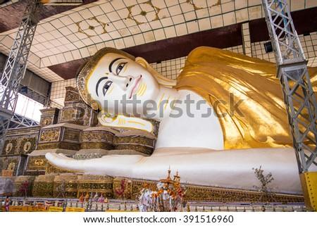 Beautiful Reclining buddha image , Chauk htat gyi reclining buddha (sweet eye buddha), yangon, myanmar - stock photo