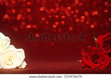 Beautiful red and white roses on sparkling red background