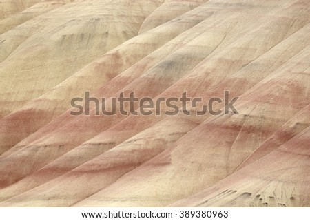 Beautiful red and yellow colored clay mounts with black manganese spots in the Painted Hills, Oregon