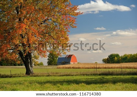 Beautiful Red barn rural farm country ,Autumn in Michigan - stock photo