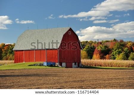 Beautiful Red barn rural farm country ,Autumn in Michigan - stock photo