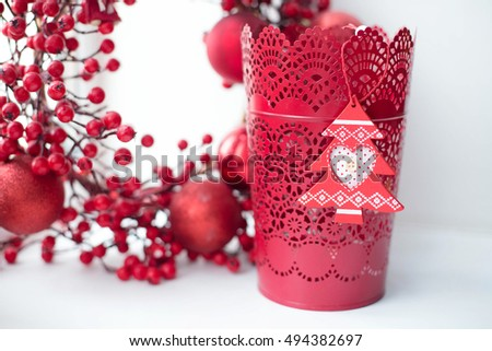 Beautiful red Christmas toys on a white background. Amazing Christmas decorations. Christmas tree with red balls on white background.