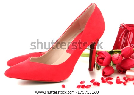 Beautiful red female shoes, isolated on white