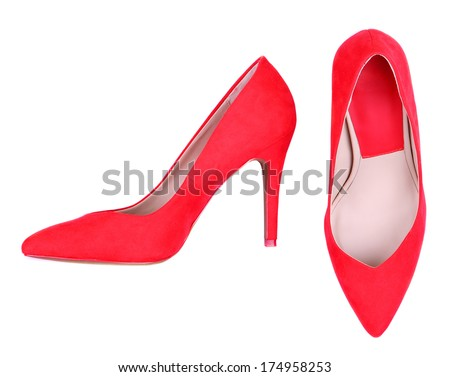 Beautiful red female shoes, on purple background