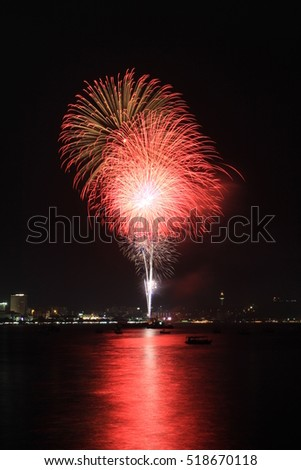 Beautiful Red Fireworks with reflecting in the sea