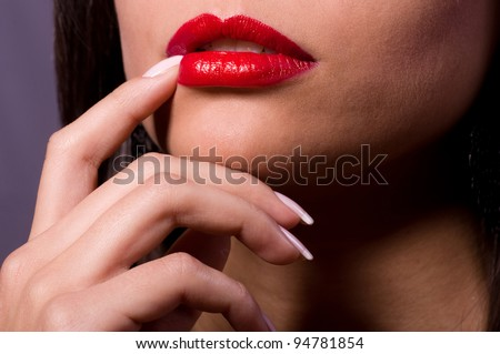 Beautiful red gloss lips with kissing gesture. - stock photo