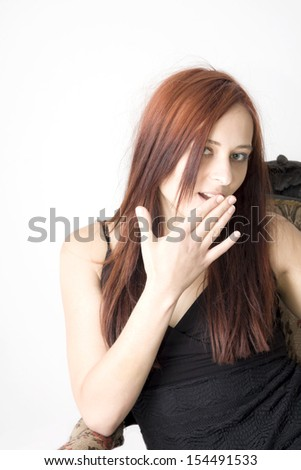 beautiful red hair girl on antique chair and grey background