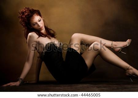 beautiful red hair woman in sexy dress, studio shot - stock photo