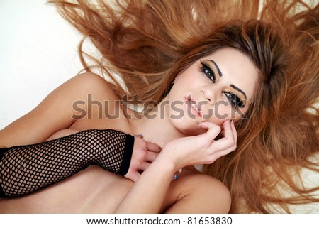 Beautiful red hair woman posing on the white background not isolated
