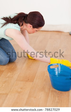 Beautiful red-haired female using a saw for diy at home - stock photo