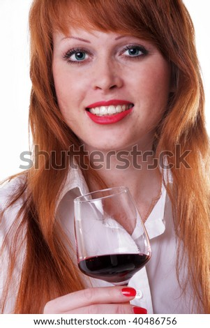 beautiful red-haired freckled girl with a red wine glass