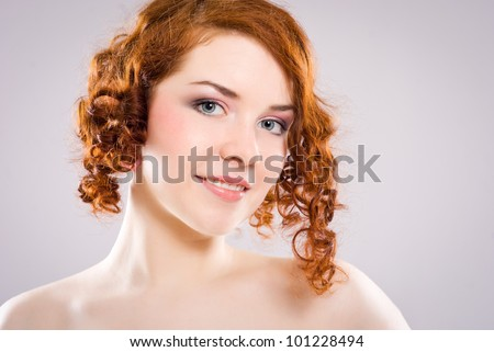 Beautiful red-haired girl's face - stock photo