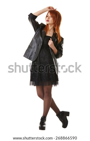 Beautiful red-haired model touts gothic clothing - stock photo